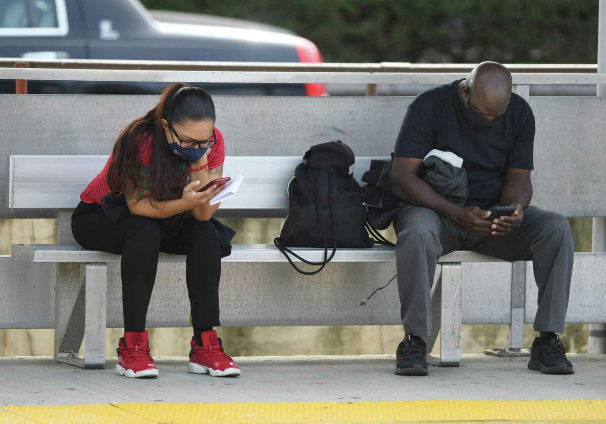 Commuters wear masks while waiting for their train on the platform of the Metro-North station in downtown Greenwich, Conn. Monday, Sept. 14, 2020.