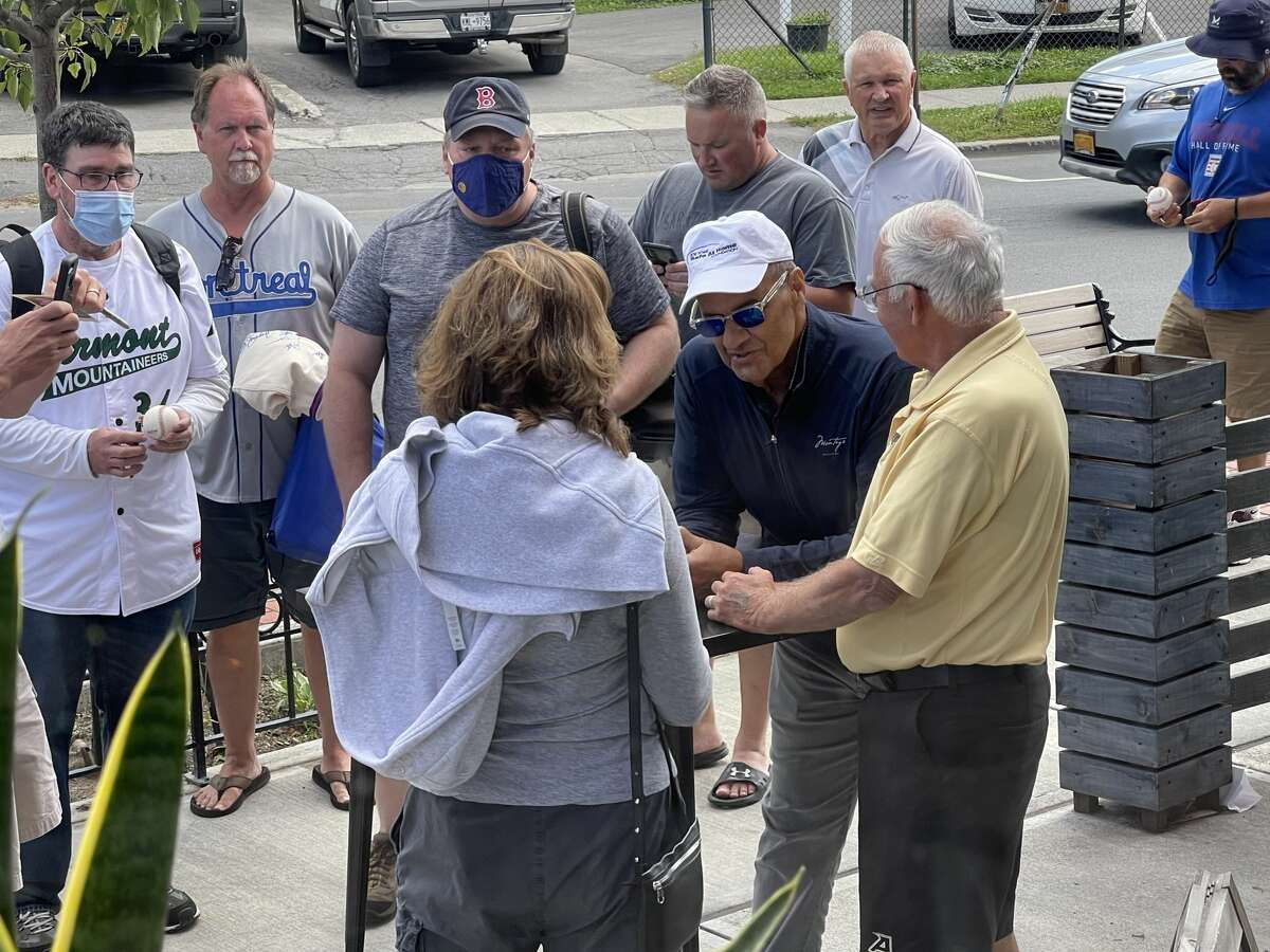 U.S. baseball executive Joe Torre signs autographs in Cooperstown, New York on Tuesday, Sept. 7, 2021.