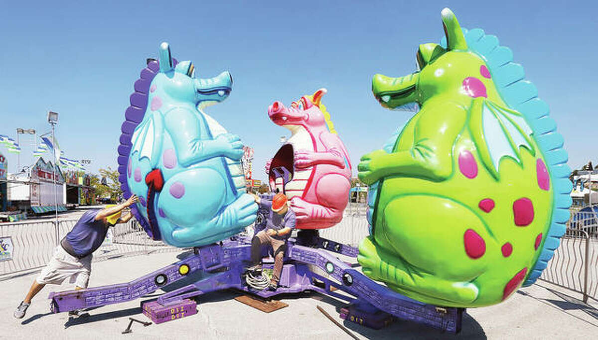 Employees from Luehrs' Ideal Rides work on setting up the Dizzy Dragons Tuesday in Alton's Riverfront Park for the annual Alton Expo which opens at 5 p.m. Wednesday. The expo will open at the same time on Thursday and Friday and will have expanded hours over the weekend.The carnival left Bethalto after Monday and came straight to Alton to begin set up for the expo.
