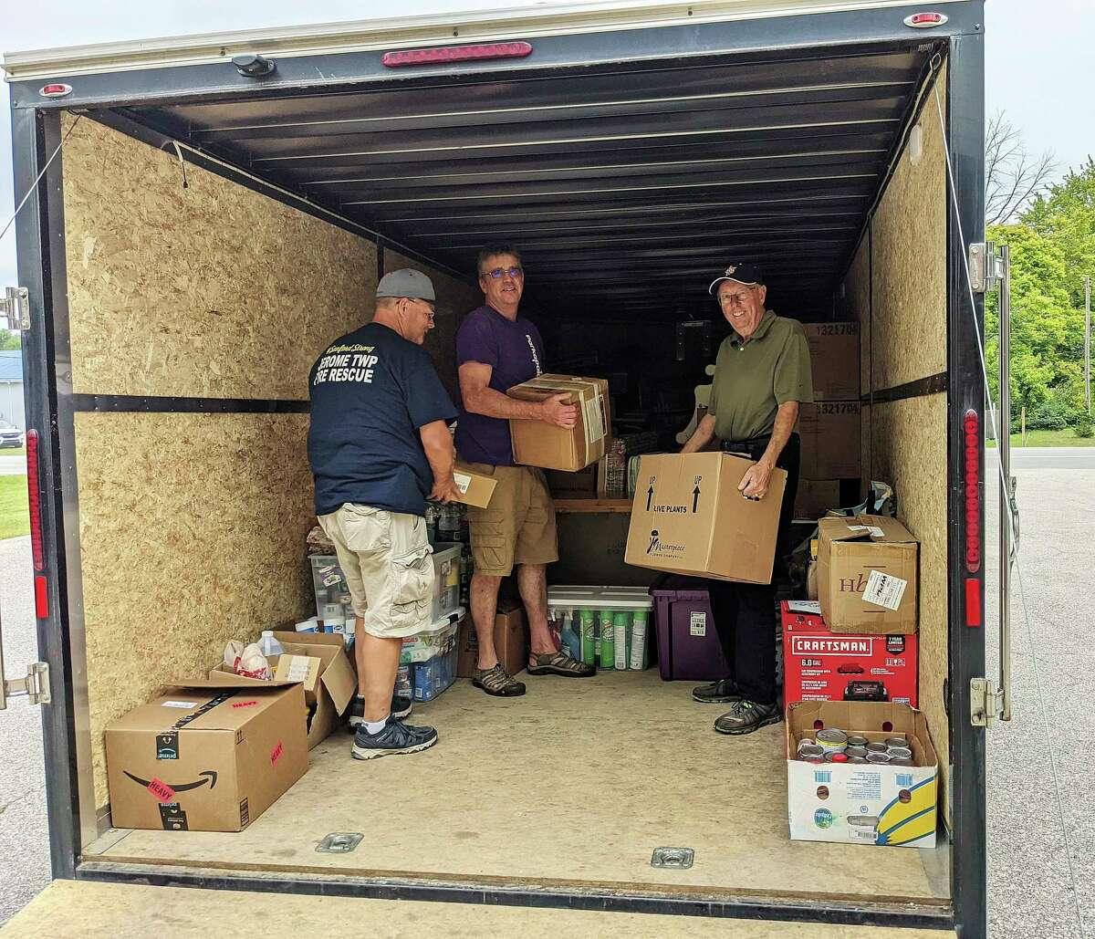 From left, Dean Merillat, Steve Rice and Dennis Peden organize supplies to be transported to the residents of Waverly, Tennessee to assist with flood recovery. (Photo provided)