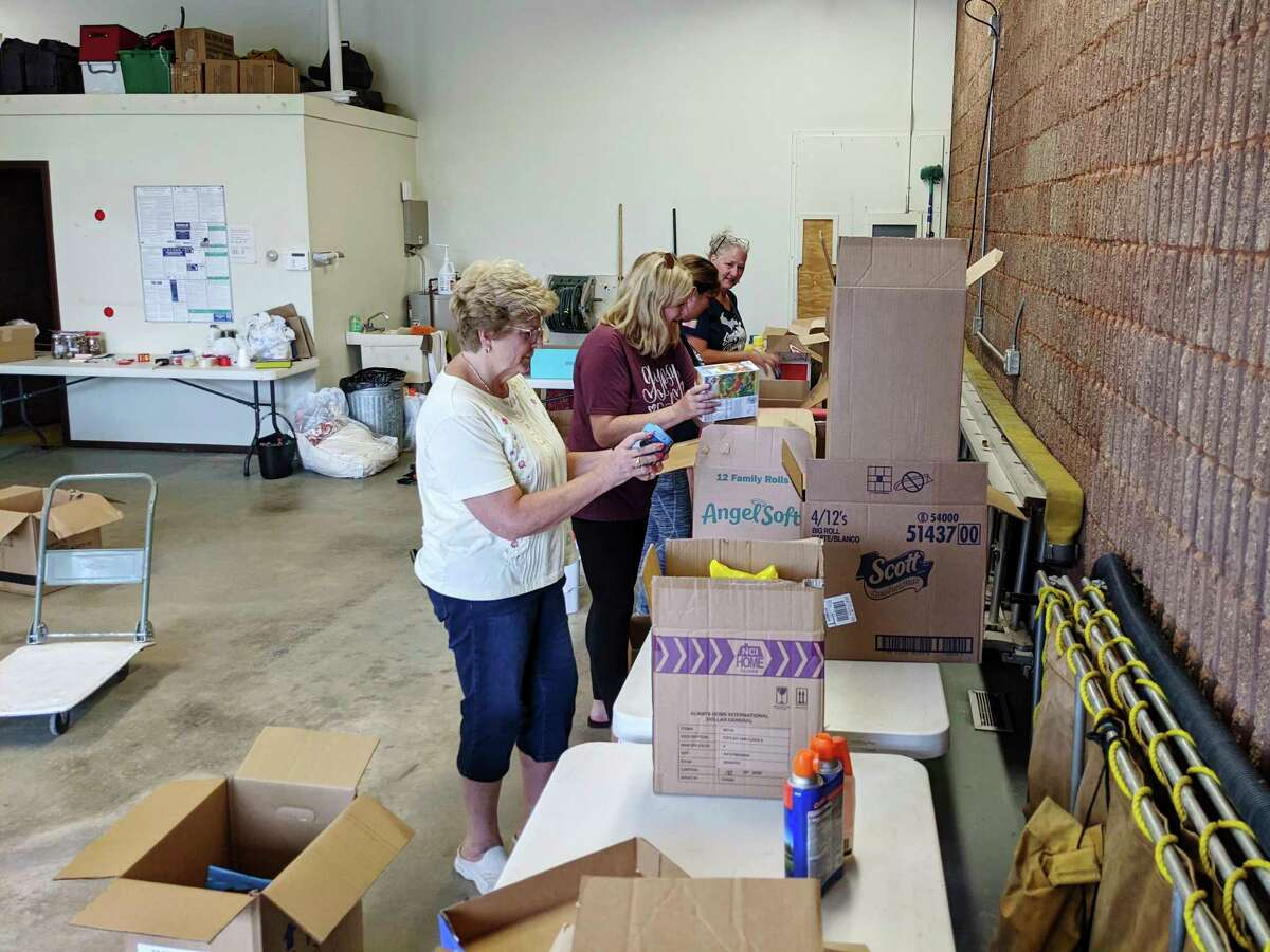 Residents of Sanford organize before transporting them to the residents of Waverly, Tennessee to assist with flood recovery. (Photo provided)