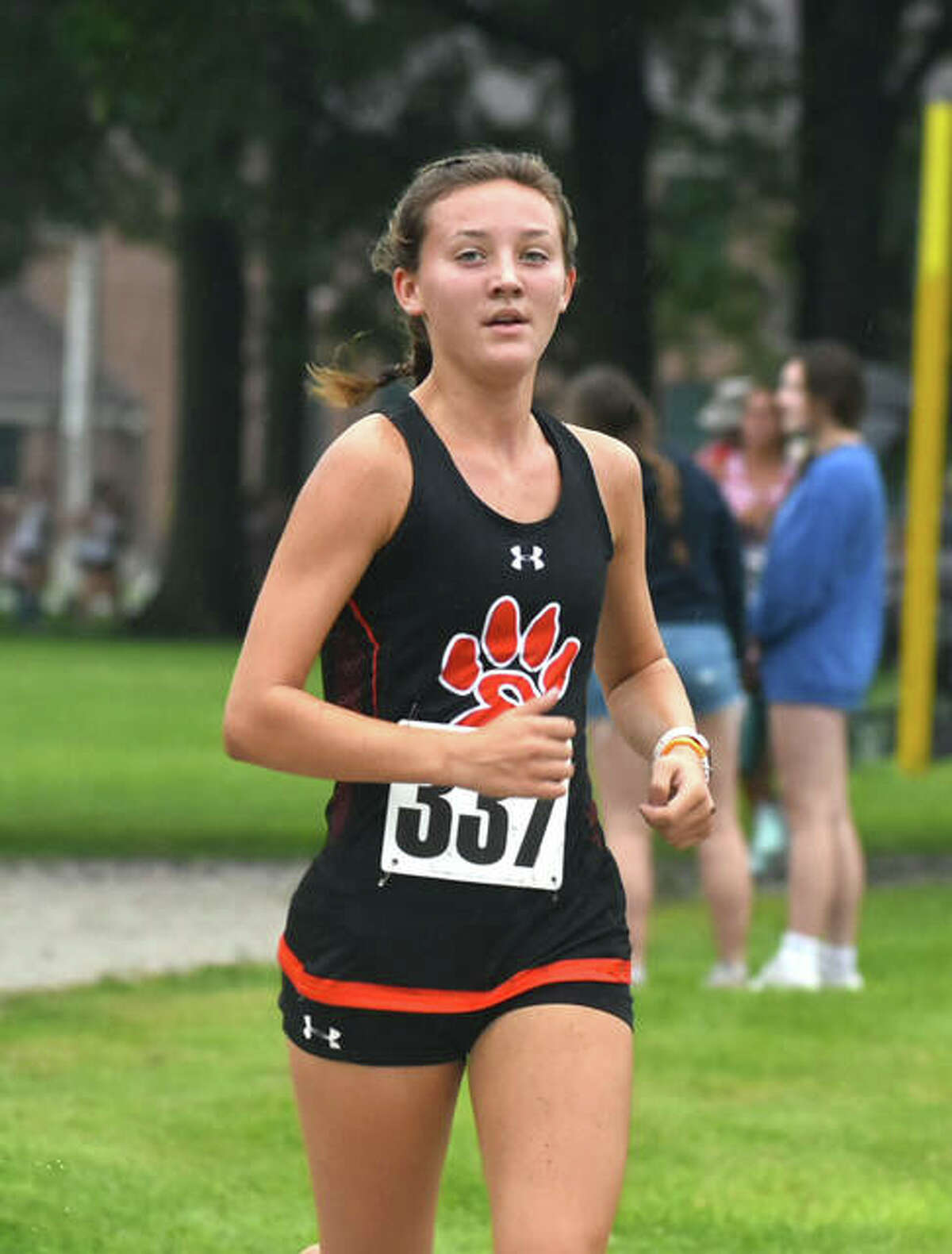 Edwardsville's Emily Nuttall runs through Maxwell Park during the Granite City Invitational on Saturday in Granite City.