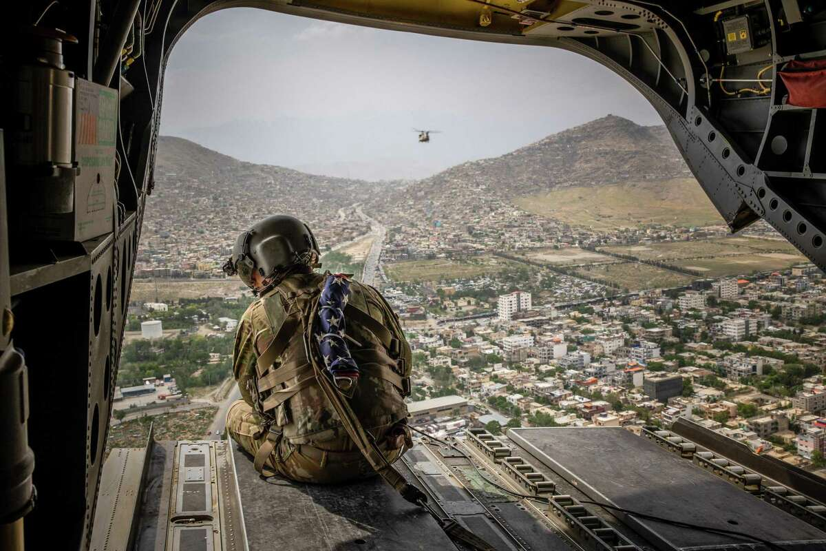 An American soldier looks out on Kabul in May. It would be a mistake to assume this defeat marks the end of American global power.
