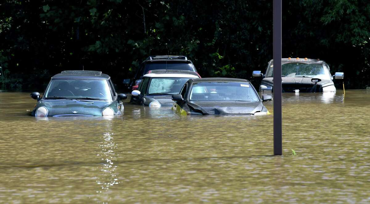 Cars parked in a lot at EZ2Drive Auto Group on Federal Rd in Danbury are partially submerged Thursday morning, Sept. 2, 2021, after heavy rains resulting from Hurricane Ida drenched the are the day before and into the night.