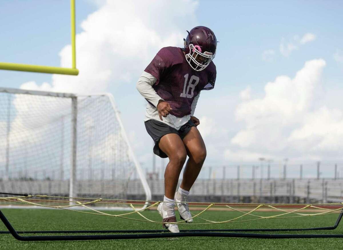 Summer creek linebacker Julian Ortiz (18) practices agility drills during football practice at Summer Creek High School, Wednesday, Aug. 11, 2021, in Houston.