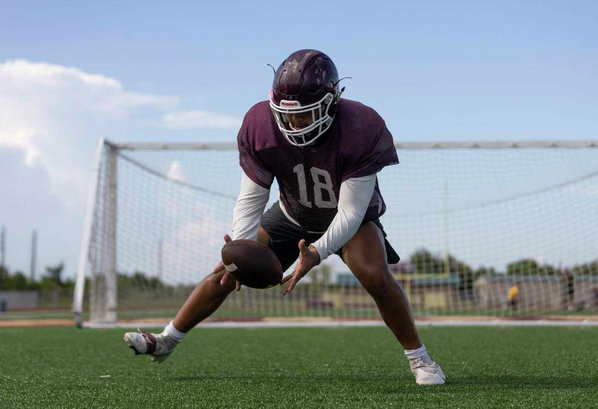 Summer creek linebacker Julian Ortiz (18) practices agility drills during football practice at Summer Creek High School.