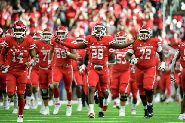 Houston runs out before an NCAA college football game against Houston Saturday, Sept. 4, 2021, in Houston. (AP Photo/Justin Rex)