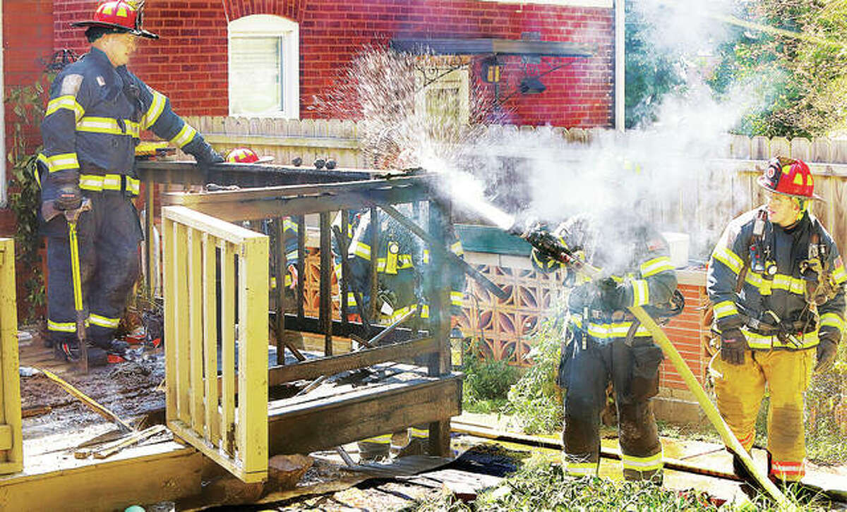 Alton firefighters put out hotspots on a deck at the rear of a home Tuesday in the 400 block of East 9th Street on Tuesday afternoon. The call came in around 2 p.m. and firefighters arrived to find flames on the small deck at the rear of the home. Firefighters had to pull up some of the decking to fully extinguish the fire. No injuries were reported.