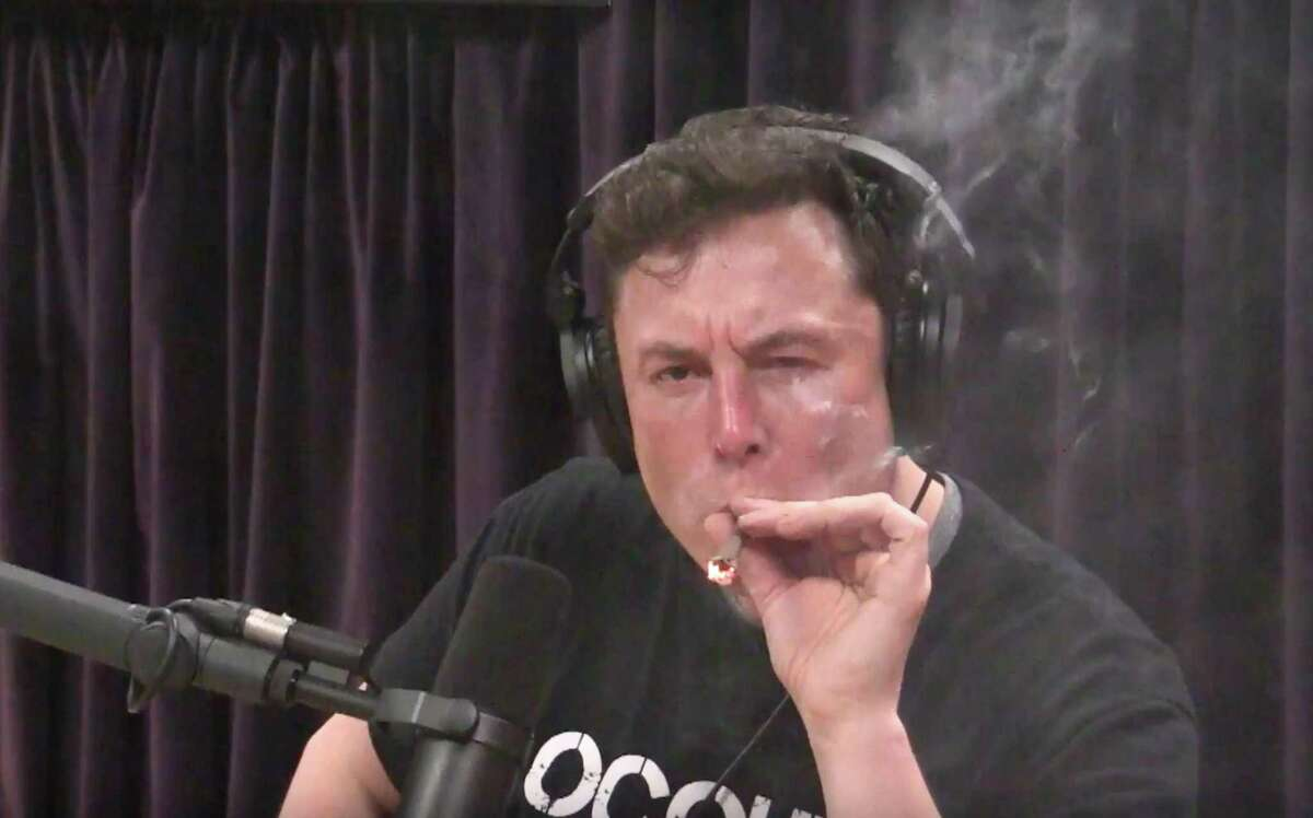 Elon Musk, chairman and CEO at Tesla and chairman of SpaceX, inhales what he said was marijuana on a live YouTube webcast Thursday night. (Screenshot/Youtube)