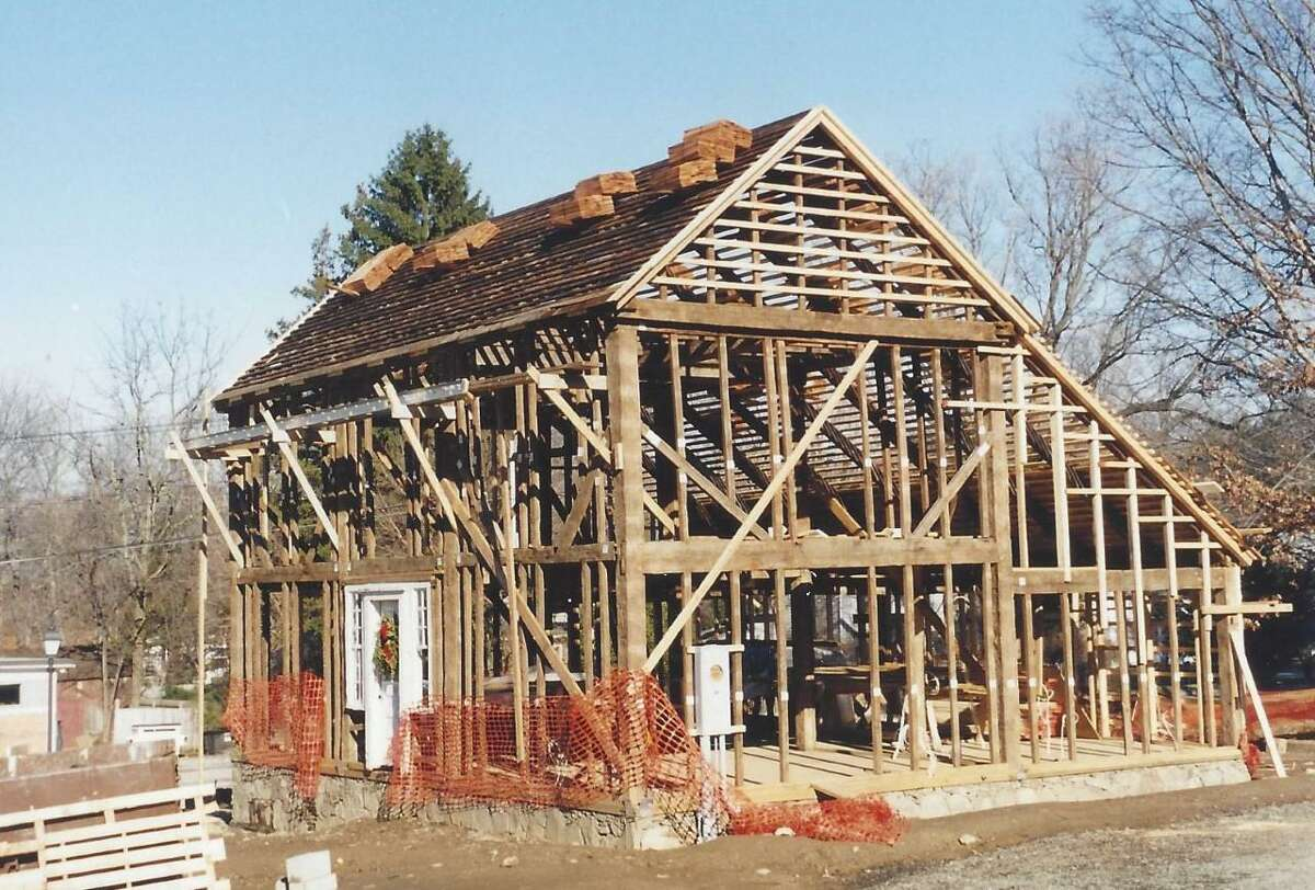 The Ridgefield Historical Society will mark 20 years at the 1714 Scott House next month. Pictured is the Scott House in 2001 as it was being reassembled at 4 Sunset Lane.