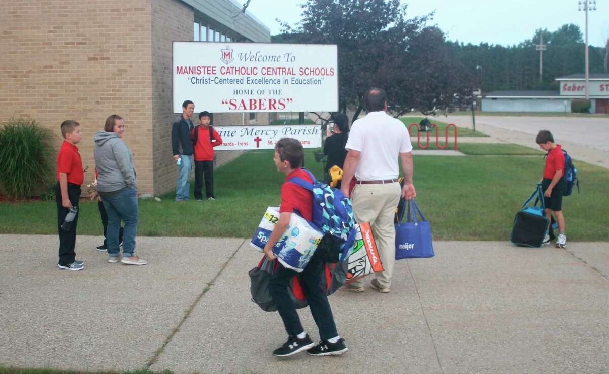 Manistee Catholic Central students and parents head to the school for the first day of class on Tuesday morning. (Kyle Kotecki/News Advocate)
