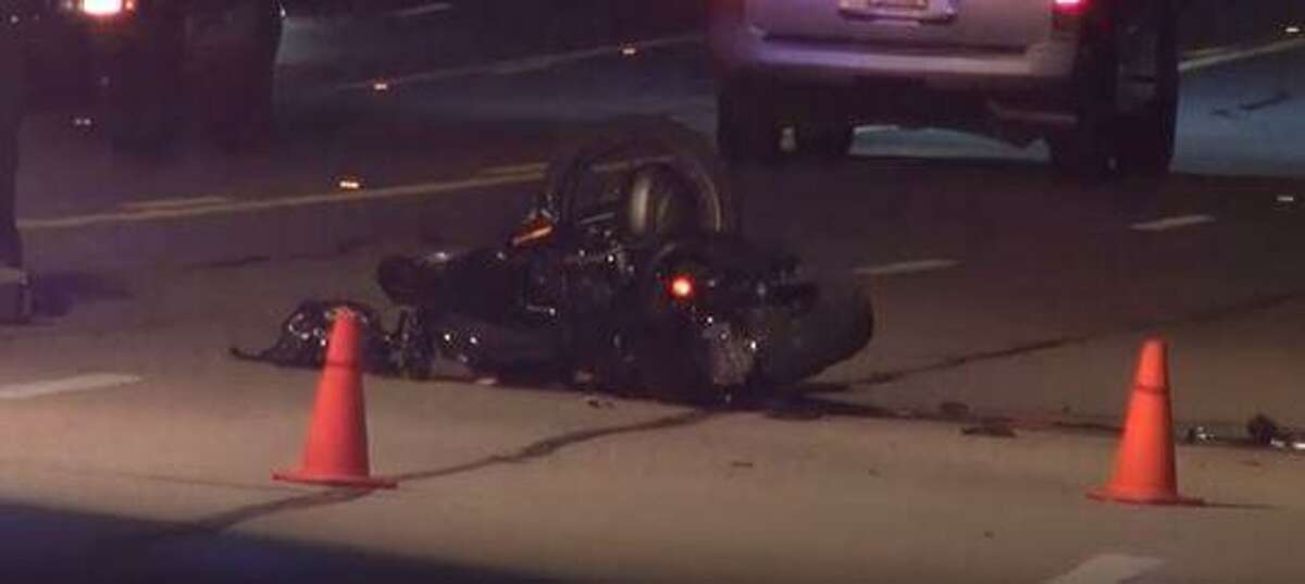 A Harley-Davidson motorcycle is seen on Loop 336 in Conroe following a crash with a car that left the motorcyclist dead.