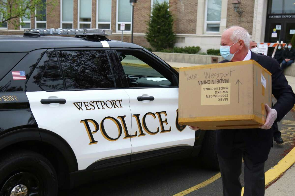 Westport's First Selectman Jim Marpe picks up the donation of mask for Westport first responders on Wednesday at Town Hall in Darien in 2020.