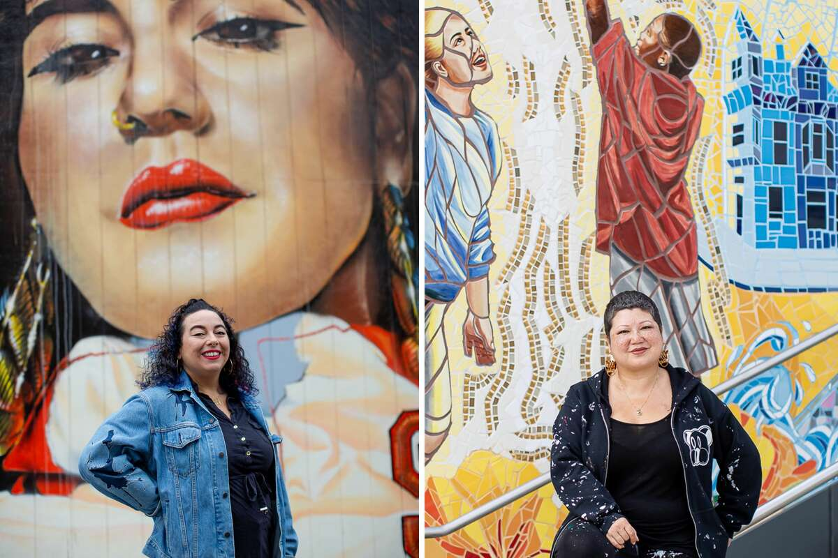 Muralists DJ Agana, left, and Marina Perez-Wong, right, pose in front of their respective sports murals in San Francisco.