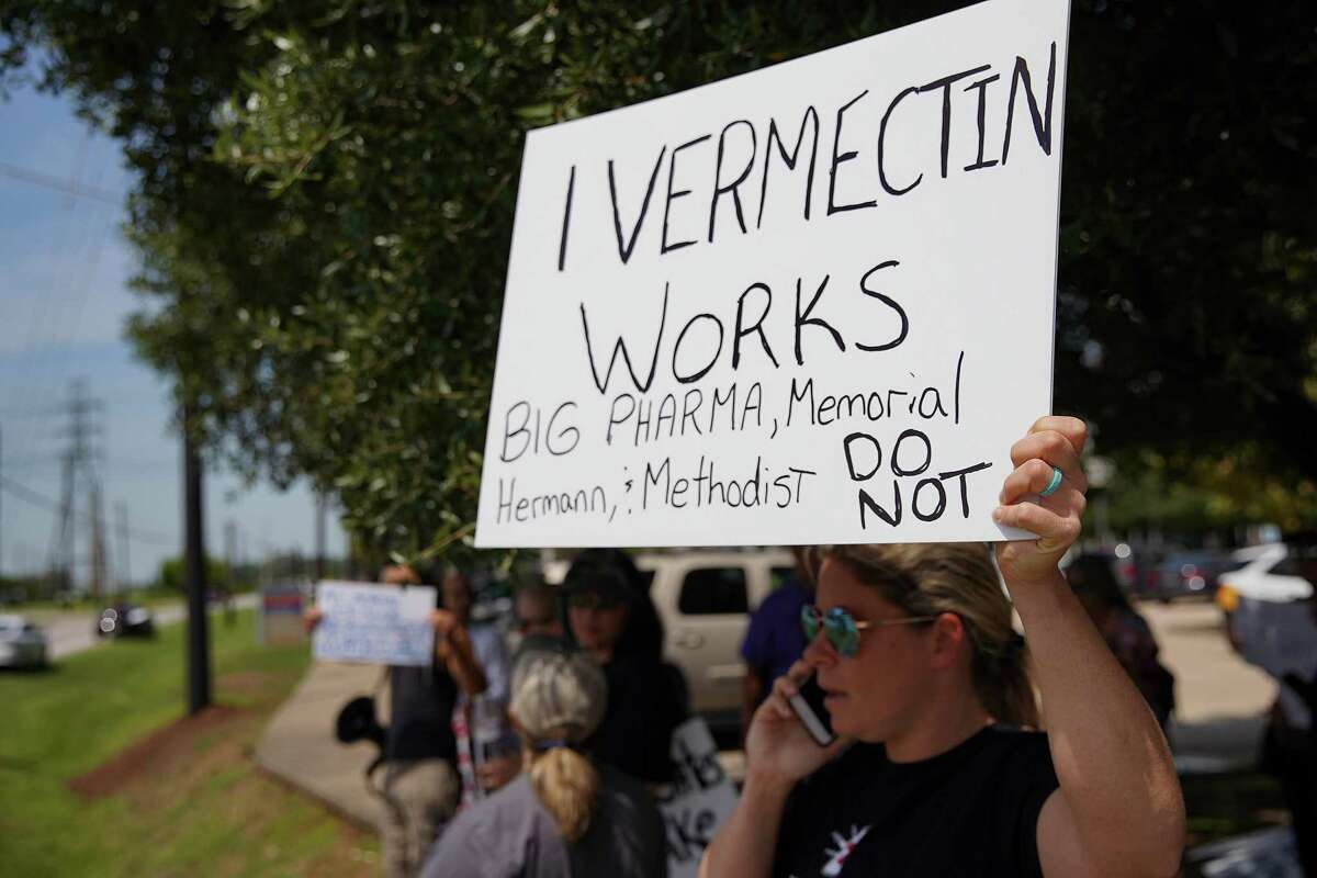 Protesters including Jennifer Bridges stand in front of Memorial Hermann in Sugar Land on Tuesday, Sept. 7, 2021. A patient that was admitted for COVID-19, Pete Lopez, passed away while the family was trying to get the hospital to administer ivermectin.