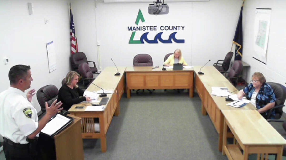 (Left) Josh Glass, Manistee City Police Department chief, presented notes on Friday to the Manistee County Public Safety Committee on what the city had recently seen for increased complaint numbers overall as well as violent crime increases.