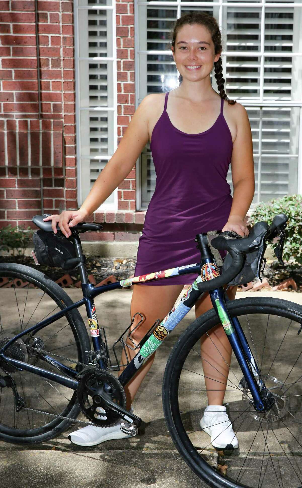 Lilian Velez, 23, at her home in Houston on Friday, Aug. 20, 2021. Velez survived ovarian cancer at age 13. She just returned a bike ride across the U.S. to raise money for cancer.