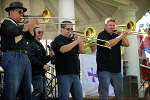 A trio of trombones take center stage during the Bridgeport-based salsa band Afinke's performance at the first annual Stratford Latin Music Festival on Paradise Green in Stratford, Conn. on Sunday, September 15, 2013.