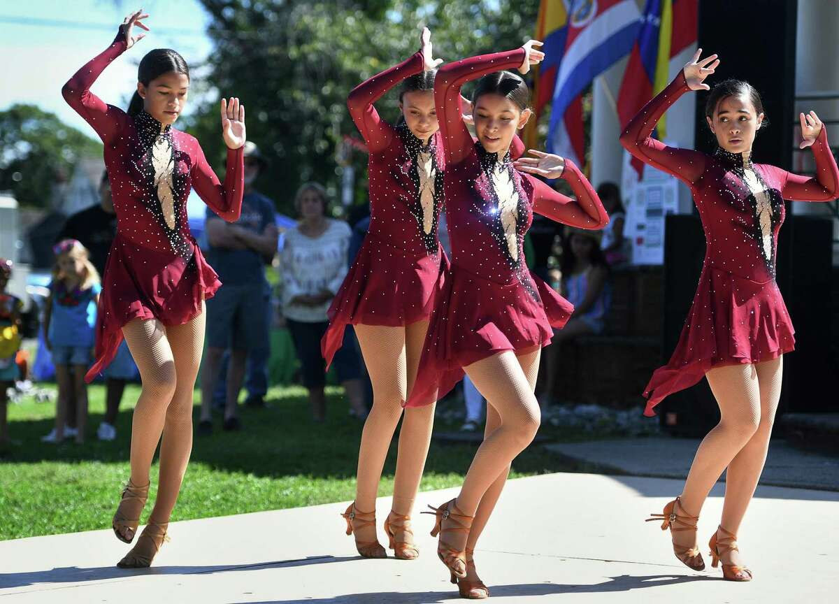 The Latin Fusion Divas, from the Latin Rhythm Dance Studio in Stratford, perform at the annual Latin Music Festival on Paradise Green in Stratford, Conn. on Sunday, September 15, 2019. From left are Alicia Marrero, Olivia Cardenes, London Diaz, and Aaliyah Vazquez.