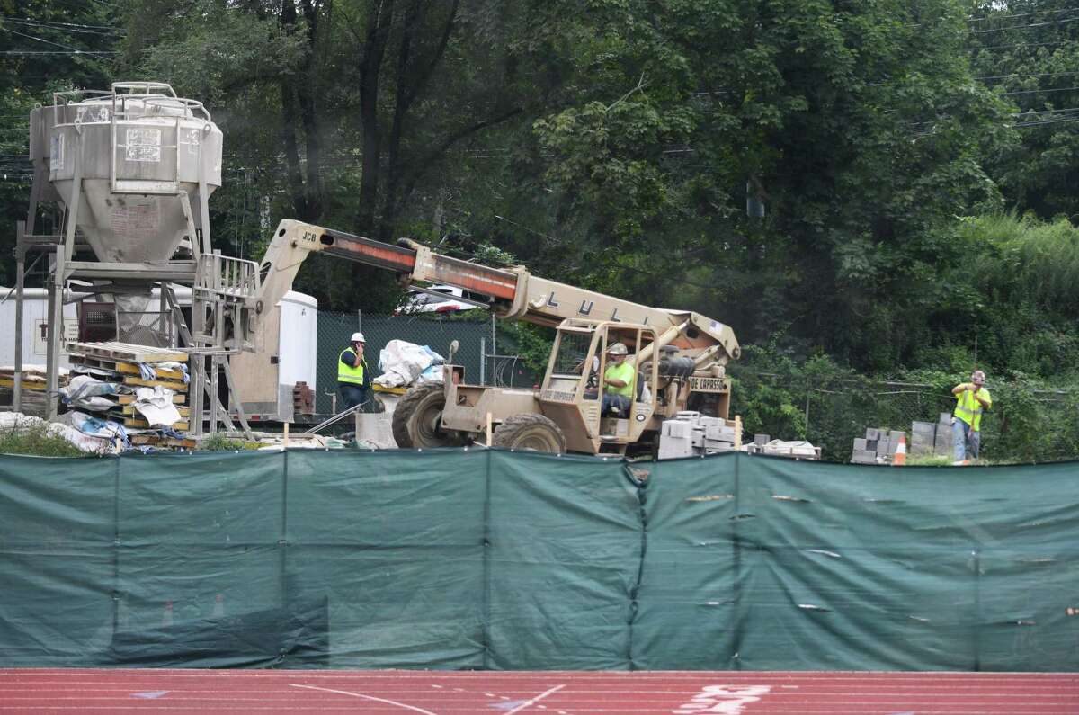 Construction continues on the Cardinal Stadium bleachers at Greenwich High School in Greenwich, Conn. Monday, Aug. 30, 2021.