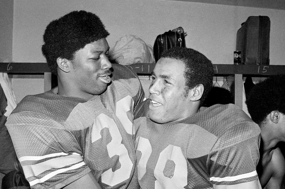 Fullback Sam Cunningham (left) and running back Anthony Davis helped make USC a powerhouse in the 1970s.