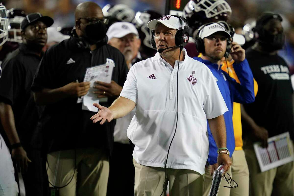 Texas A&M head coach Jimbo Fisher argues a call with a referee during the first half of an NCAA college football game against Kent State on Saturday, Sept. 4, 2021, in College Station, Texas. (AP Photo/Sam Craft)