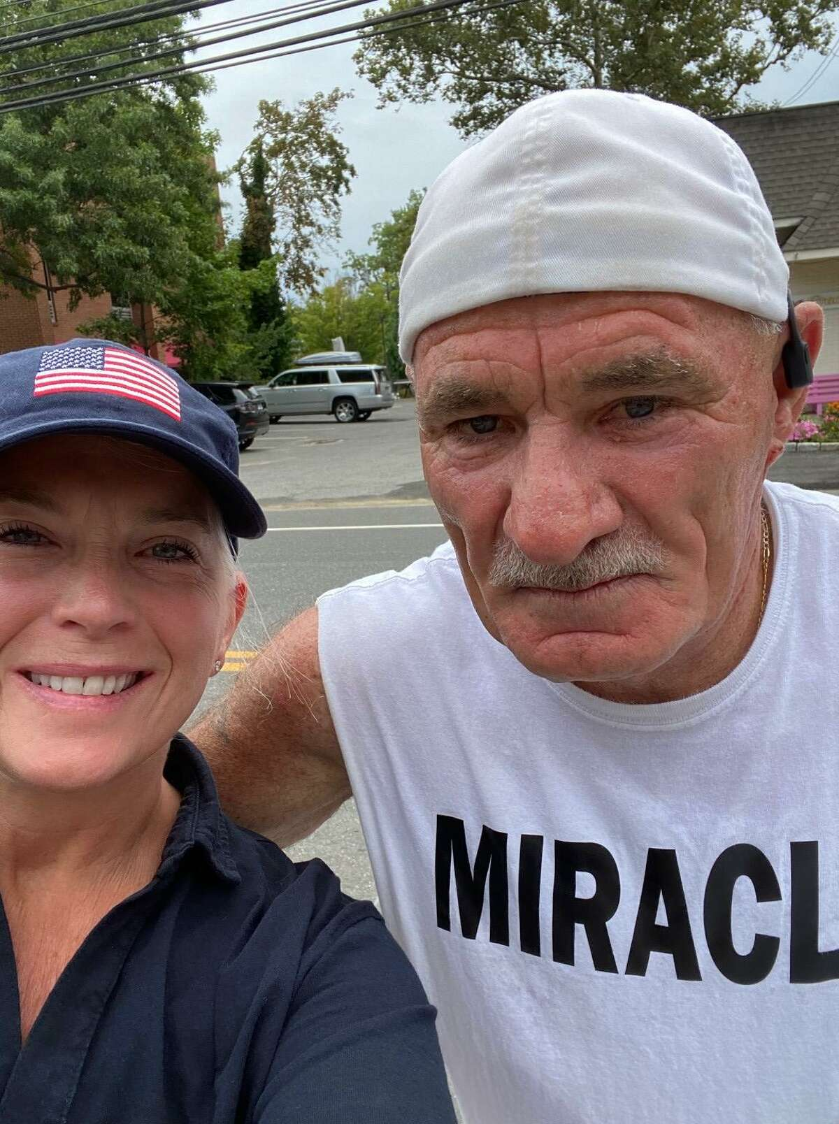 """Darien First Selectwoman Jayme Stevenson poses with Paul """"Paulie"""" Veneto in Darien along his journey from Logan Airport in Boston to ground zero in New York City. The walk honors those killed on 9/11 20 years ago."""