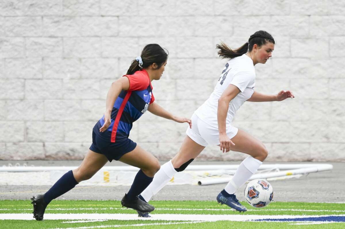 Northwood's Jessica Piper turns it upfield during an April 24, 2021 game against Saginaw Valley State.