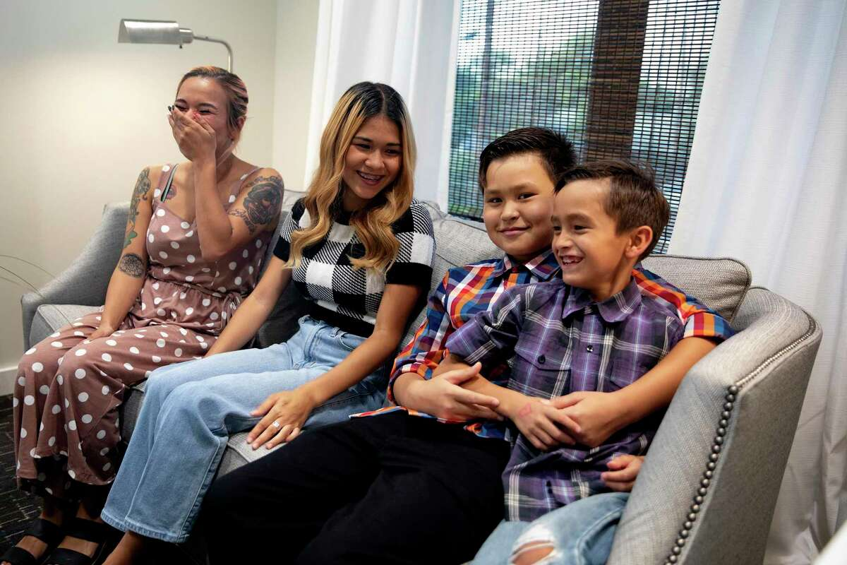 Vanessa Ibarra and her three children, Mia, Joshua and Yurjah sit in one of the new teen rooms at The Children's Bereavement Center of South Texas. The center, which has recently expanded, helped the children in dealing with the loss of their father last year.