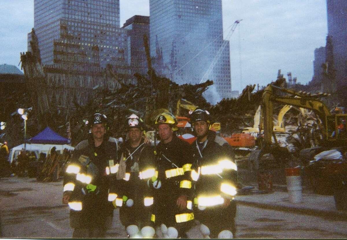 "Greenwich volunteer firefighters Sandy Kornberg, Anthony Medico, Andrew ""Duke"" Maloney and Frank Napolitano at Ground Zero on Sept. 27, 2001."