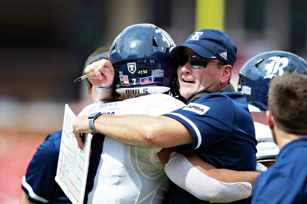 Rice's Jordan Myers, left, earned coach Mike Bloomgren's appreciation after scoring on a 1-yard run in the second quarter to give Rice a 10-7 lead over Arkansas on Saturday.