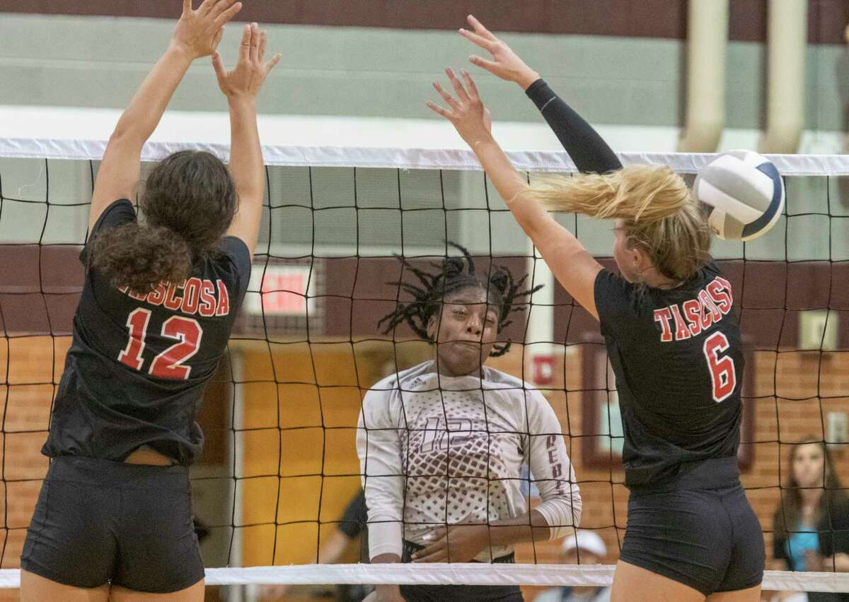 Legacy High's Christallynn Tate gets the kill as Tascosa's Megan Sims and Alex Ayres try to block it 09/07/2021 at Legacy High gym. Tim Fischer/Reporter-Telegram
