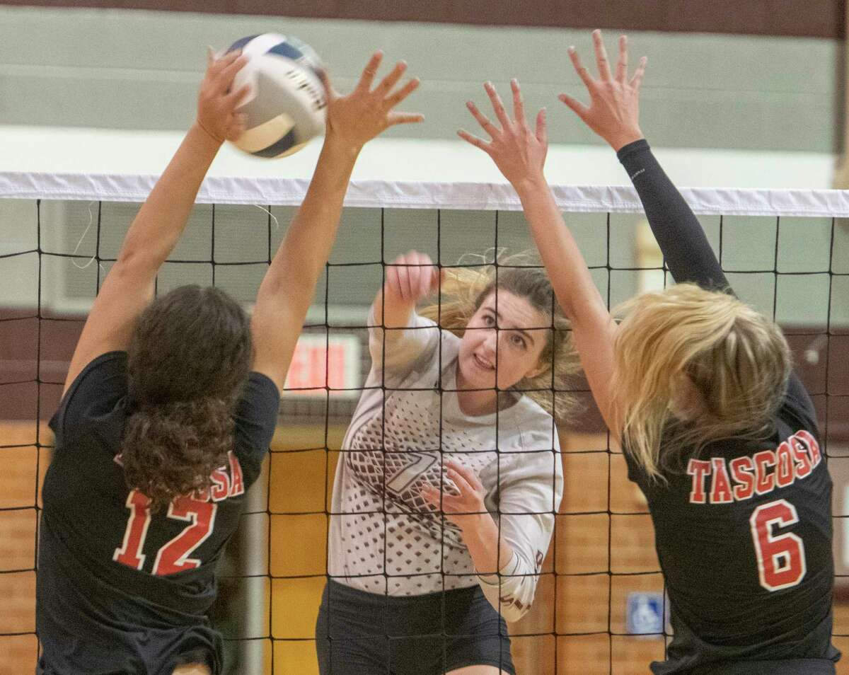 Legacy High's Kendall Harrington tries to get the ball past Tascosa's Megan Sims and Alex Ayres who try to block it 09/07/2021 at Legacy High gym. Tim Fischer/Reporter-Telegram
