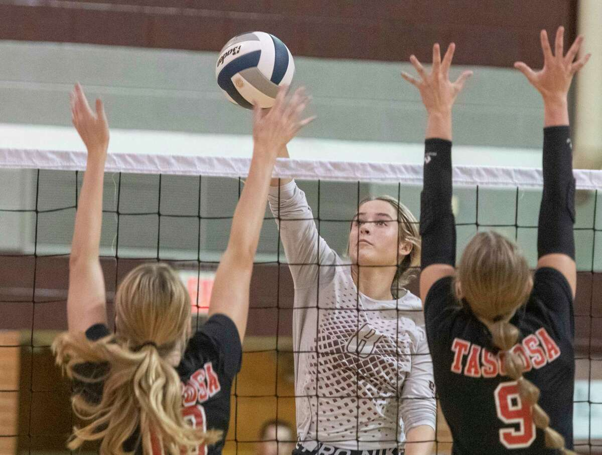 Legacy High's Callie McCright looks to tip the ball out of the reach of Tascosa's Megan Sims and Abrey Galt 09/07/2021 at Legacy High gym. Tim Fischer/Reporter-Telegram