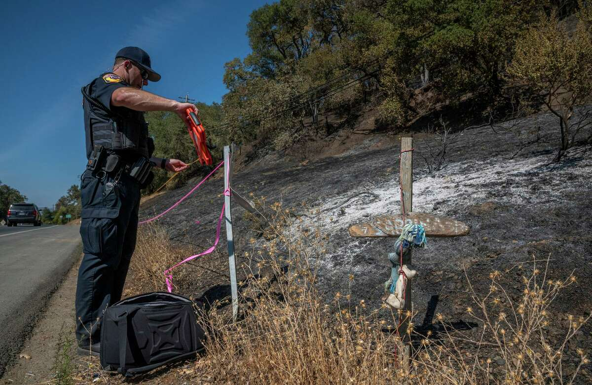 Cal Fire investigator Jeremy Ward surveys evidence on Healdsburg Avenue, where one of several fires hit the area Monday night.
