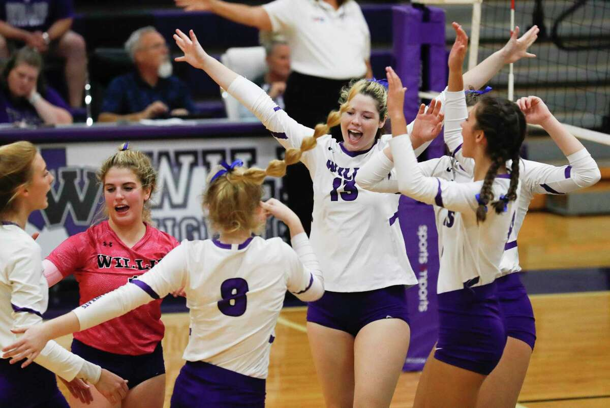 Willis' Georgia Everett (13) reacts with teammates after scoring a point during the third set of a high school volleyball match at Willis High School, Tuesday, Sept. 7, 2021, in Willis.