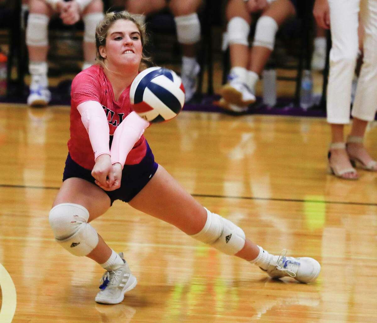 Willis' Caroline Woodfill (1) returns a hit during the third set of a high school volleyball match at Willis High School, Tuesday, Sept. 7, 2021, in Willis.