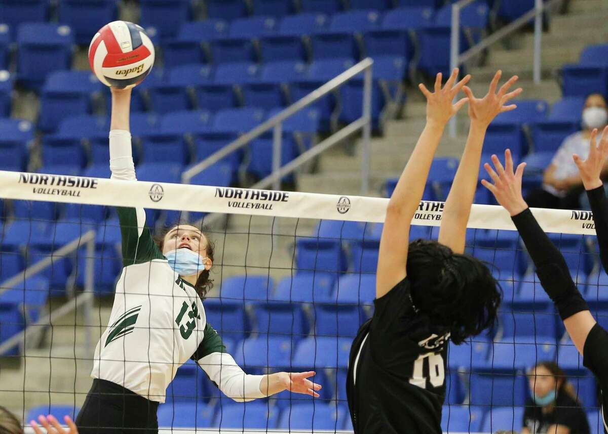Reagan's Katie Hill (13) looks to score for her team against Clark's Sofie Schemerman (16) in girls volleyball at Northside Gym on Tuesday, Sept. 7, 2021. Hill also had two aces in the final game to cap the win for the Rattlers. The Rattlers defeated the Cougars 3-1 in sets to take the matchup.
