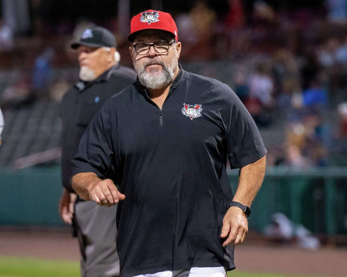 Tri-City ValleyCats coach Pete Incaviglia walks back to the dugout after checking on a player during a game against the Sussex County Miners at the Joseph L. Bruno Stadium on the Hudson Valley Community College in Troy, NY, on Tuesday. Sept. 7, 2021. (Jim Franco/Special to the Times Union)
