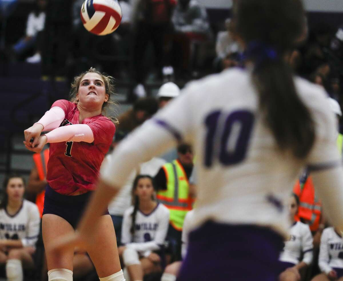 Willis' Caroline Woodfill (1) passes the ball during the second set of a high school volleyball match at Willis High School, Tuesday, Sept. 7, 2021, in Willis.