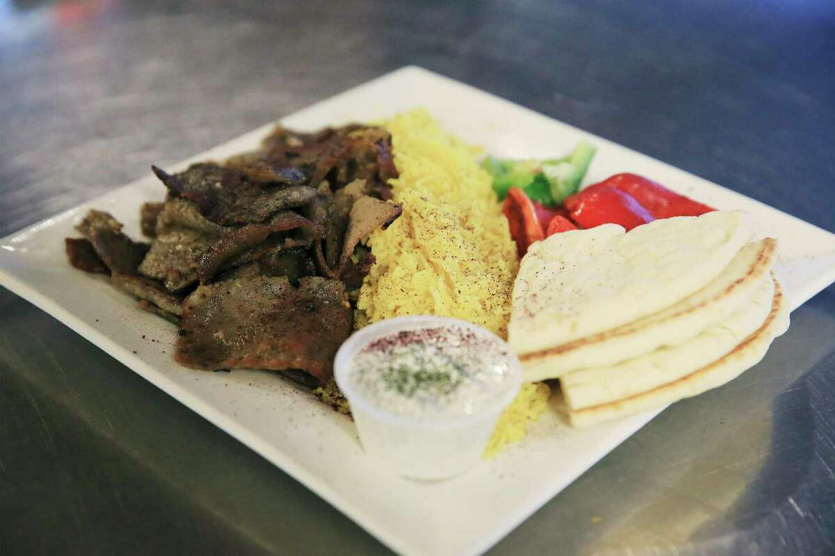 """A gyro plate is among the dishes that introduce some diners to Mediterranean food. """"People get to ask questions, and sometimes the conversations that come out of all of it, it's so beautiful,"""" Werfelli says."""