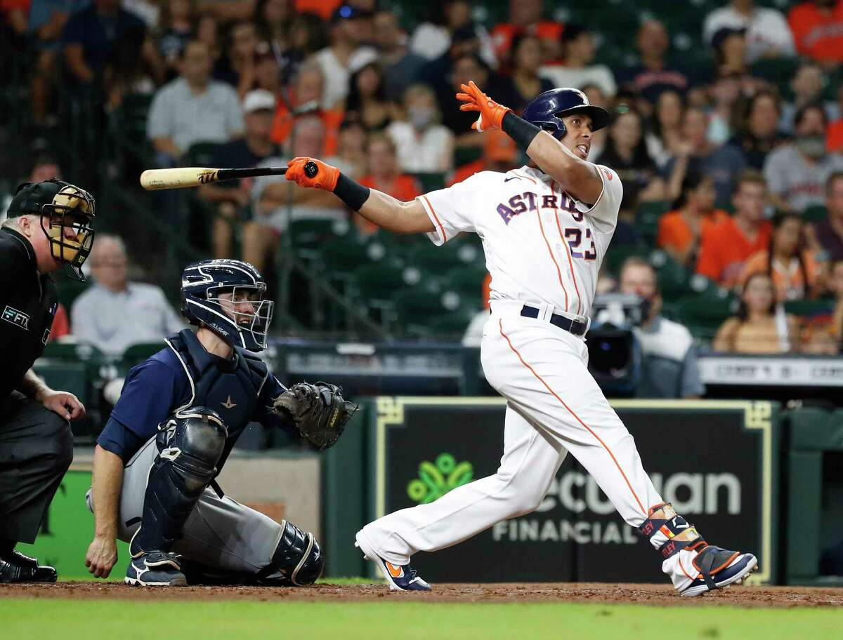 Houston Astros left fielder Michael Brantley (23) singles off of Seattle Mariners starting pitcher Logan Gilbert during the third inning of an MLB baseball game at Minute Maid Park, Tuesday, September 7, 2021, in Houston.