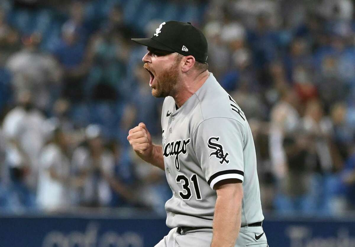 Liam Hendriks, who signed a three-year, $54 million deal with the White Sox in free agency last winter after five seasons with the A's, returned to Oakland on Tuesday as the AL saves leader.