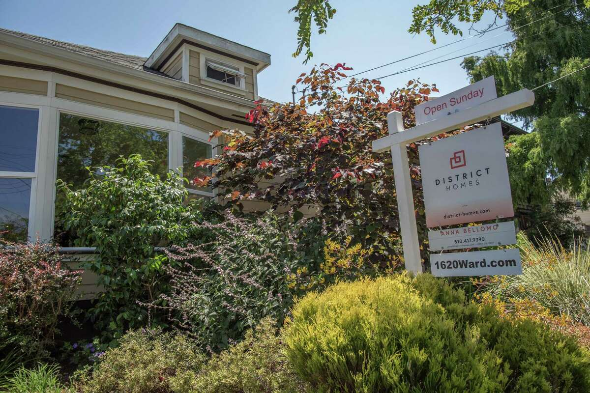 A for sale sign seen outside of a home in the South Berkeley neighborhood of Berkeley, California on July 14, 2021.