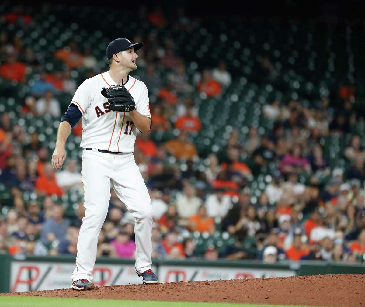 Houston Astros starting pitcher Jake Odorizzi watches Seattle Mariners J.P. Crawford's RBI double during the fifth inning of an MLB baseball game at Minute Maid Park, Tuesday, September 7, 2021, in Houston.