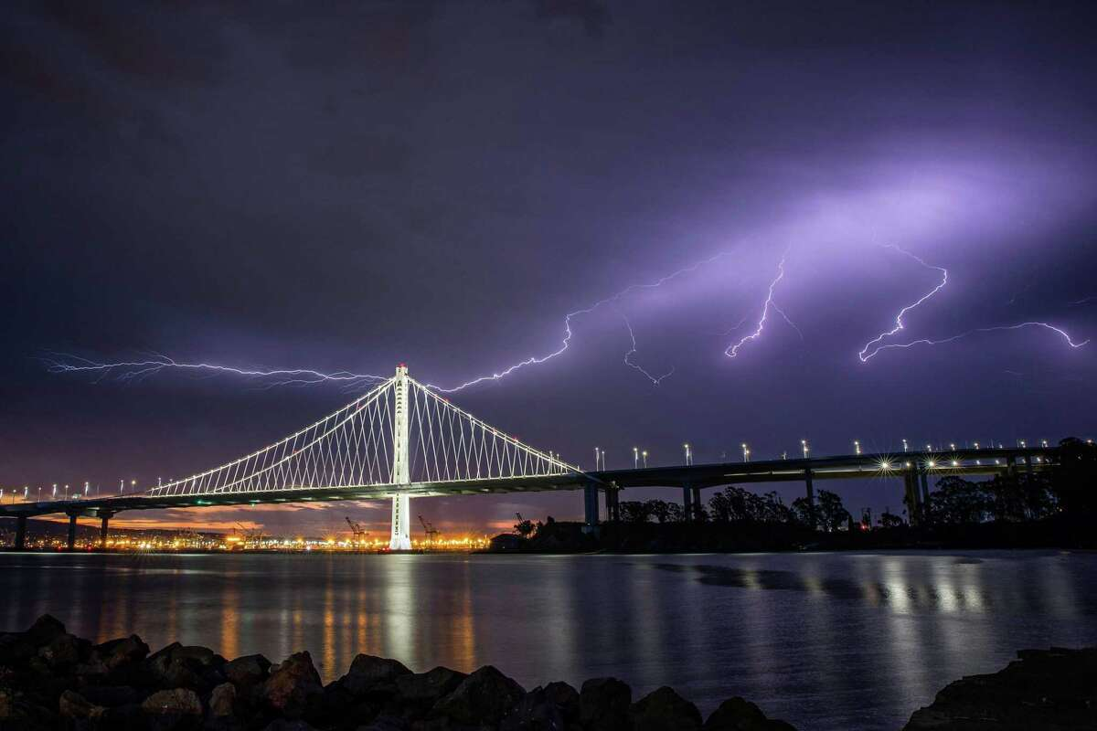 Lightning illuminates the sky over the eastern span of the Bay Bridge as a storm passed through the area on August 16, 2020. Thunderstorms with or without rain - and perhaps dry lightning - are expected in the North Bay this week.