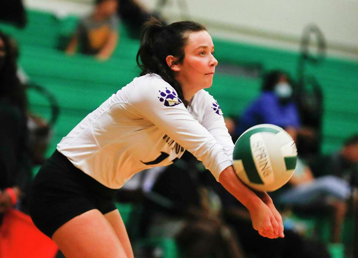 Montgomery libero Kendall Sadler (12) returns a hit in the first set of a high school volleyball match during the Spring ISD Tournament at Spring High School, Thursday, Aug. 19, 2021, in Spring.