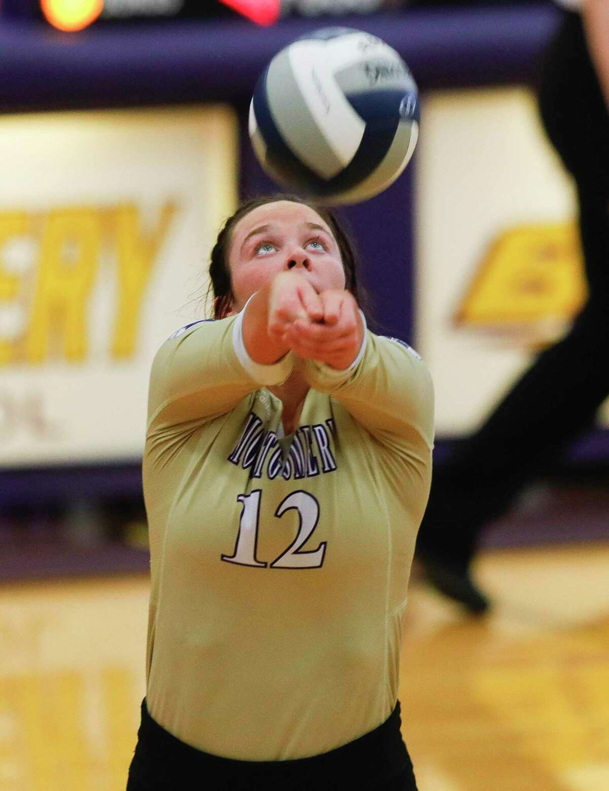 Montgomery libero Kendall Sadler (12) makes a pass in the second set of a high school volleyball match at Montgomery High School, Tuesday, Aug. 31, 2021, in Montgomery.