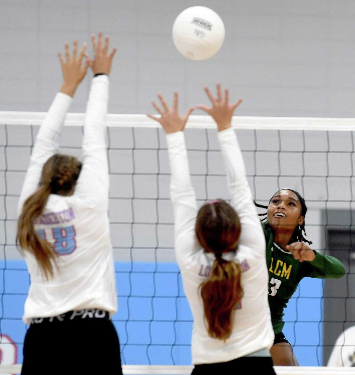 Lumberton defends as Little Cypress-Mauriceville's Trinity Williams slams the ball across the net during their volleyball matrch-up Tuesday in Lumberton. Photo made Tuesday, September 7, 2021 Kim Brent/The Enterprise
