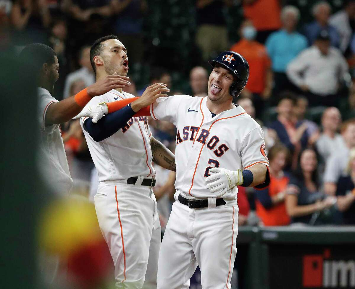 Alex Bregman (right) had the game-tying homer in the ninth inning and Carlos Correa followed with the walkoff winner in the 10th as the Astros beat the Mariners 5-4 on Tuesday night at Minute Maid Park.